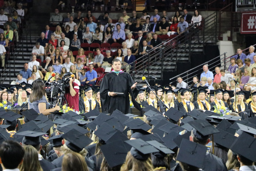 "Andy Abner, principal of Rock Canyon High School, addresses the class of 2018 at graduation on May 26 at University of Denver Magness Arena. ""This school will never be the same without you,"" he said to the graduates."