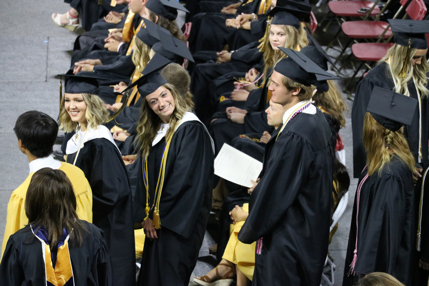 Graduates of Rock Canyon High School beam with excitement at the May 26 commencement ceremony at University of Denver Magness Arena, 2250 E Jewell Ave.