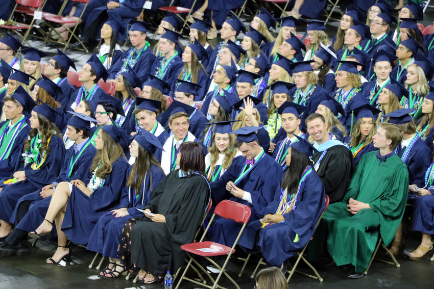 ThunderRidge High School graduates wait to receive their diplomas at the May 26 commencement ceremony at the University of Denver Magness Arena.
