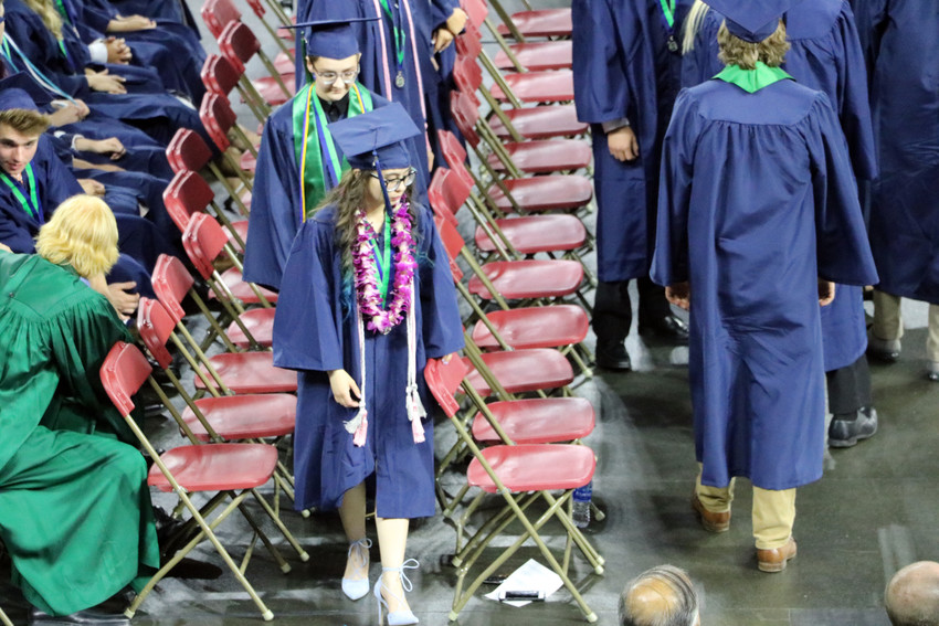 ThunderRidge High School graduates make their way to the center of the University of Denver's  arena to get their diplomas at the May 26 commencement ceremony.