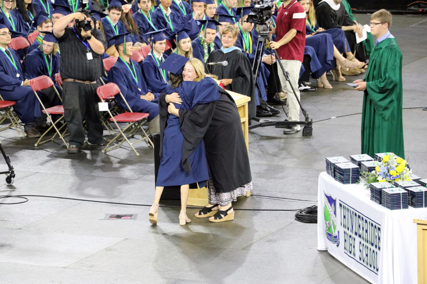 ThunderRidge High School staff send each graduate off with a hug at the May 26 commencement ceremony at the University of Denver Magness Arena, 2250 E Jewell Ave.