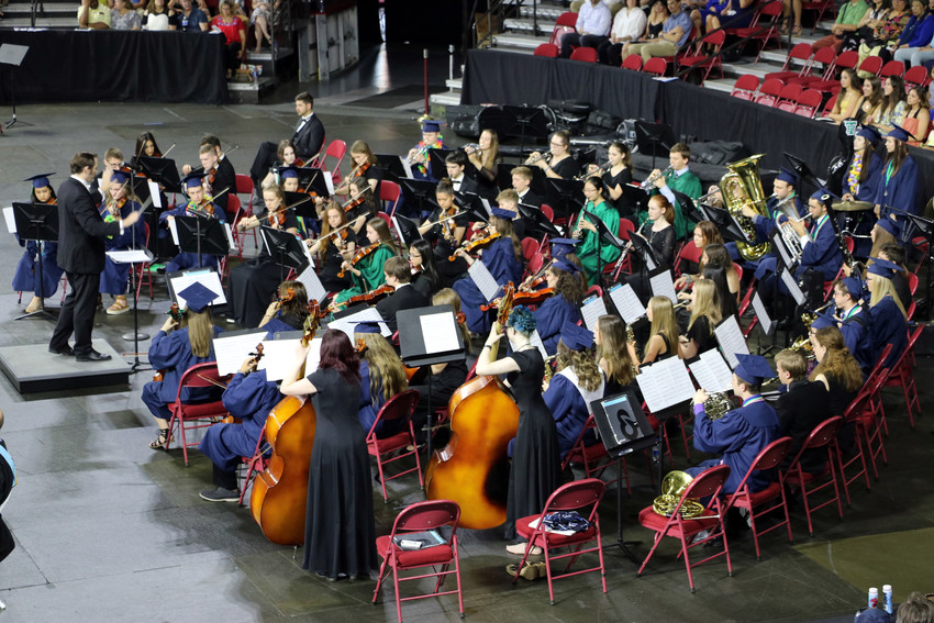 ThunderRidge High School's orchestra plays for hundreds of guests at the May 26 graduation ceremony. The music rang through University of Denver's arena.