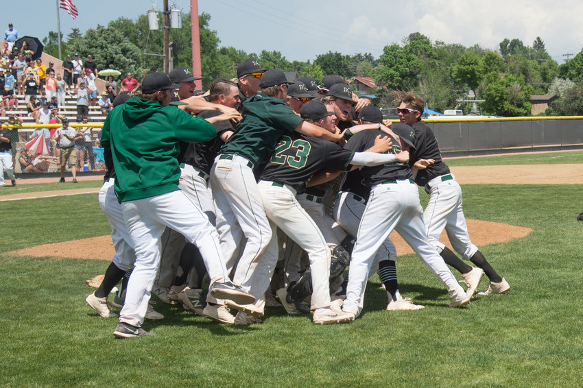 The Mountain Vista Boys Baseball team celebrate their 7-2 victory over Heritage in the 5A State Final Sunday at All City Field in Denver.