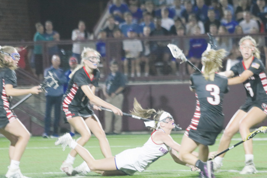 Cherry Creek's Hali Sabilia gets off a shot as she dives to the ground during the May 23 State Girls Lacrosse Championship game against Colorado Academy. Sabilia scored four goals but Colorado Academy won the game 13-7 to claim its fourth straight championship.