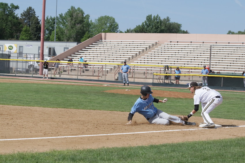 The Rock Canyon third baseman tags Angelo Domenico, Mountain Range shortstop, out during the May 22 State Class 5A baseball tournament game played at All City Stadium. Domenico was tagged out but his hit drove in a pair of runs as Mountain Range shut out Rock Canyon 4-0.