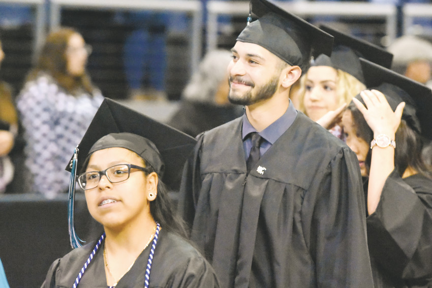 Westminster graduates enter the First Bank Center in Broomfield for commencement exercises May 19.
