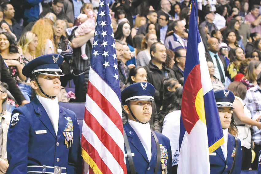 Westminster High School Air Force Junior ROTC color guard await their formal entrance to the stage during graduation ceremonies May 19 at the First Bank Center in Broomfield.