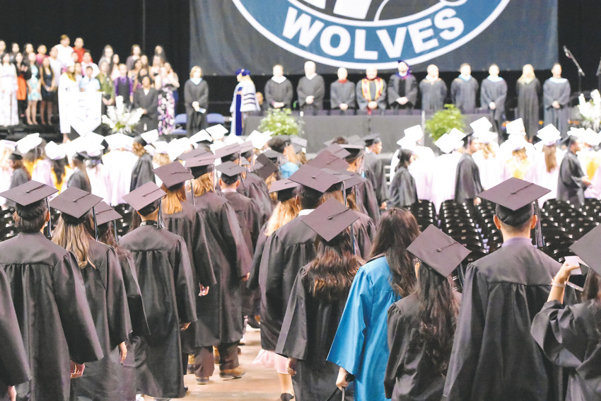 Westminster graduates take their positions on the floor of the First Bank Center in Broomfield at the start of graduation ceremonies, held May 19.