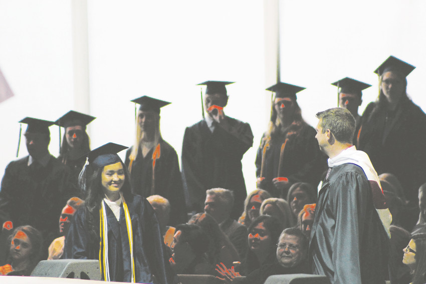 A Valor graduate hears her name called during the commencement ceremony at Cherry Hills Community Church May 24.