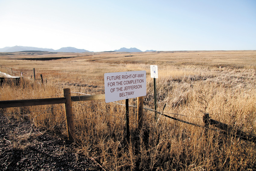 Signs near the intersection of 96th Avenue and Indiana Street used to mark where the Rocky Flats National Wildlife Refuge and the proposed 10-mile toll road Jefferson Parkway will meet.