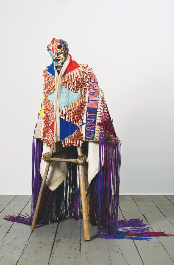 """I Can't Take My Eyes Off of You"" by Jeffrey Gibson combines his interest I American pop music and Native American art. It has tipi poles as legs, trimmed blankets and a ceramic head."