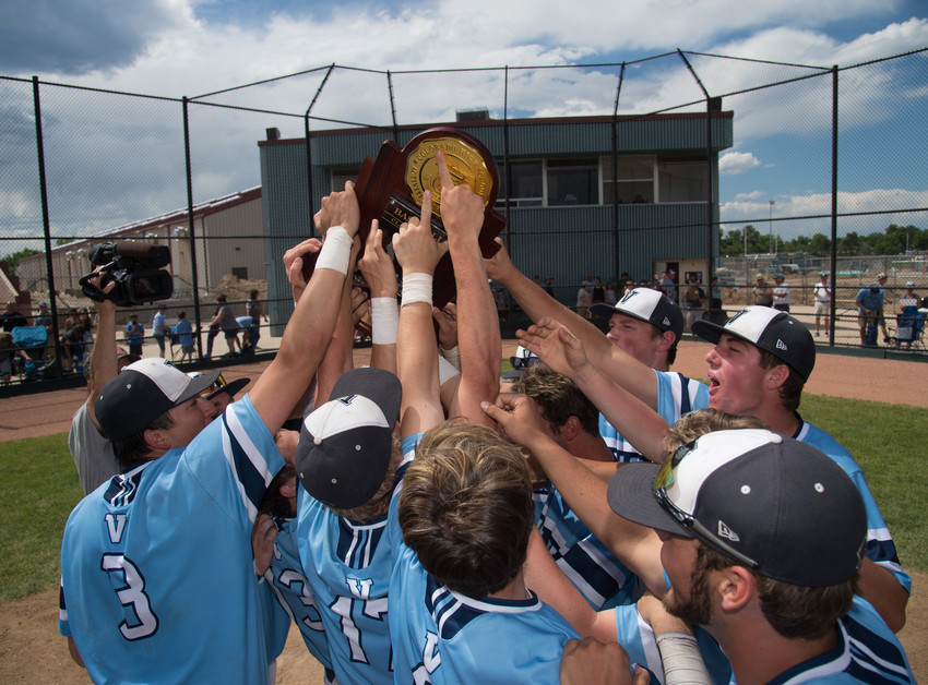 The Valor Christian Baseball team celebrates by raising their new state championship trophy.  The Eagles won 5-1 over Pueblo West on Wednesday at All City Field in Denver to make it their third championship in a row.