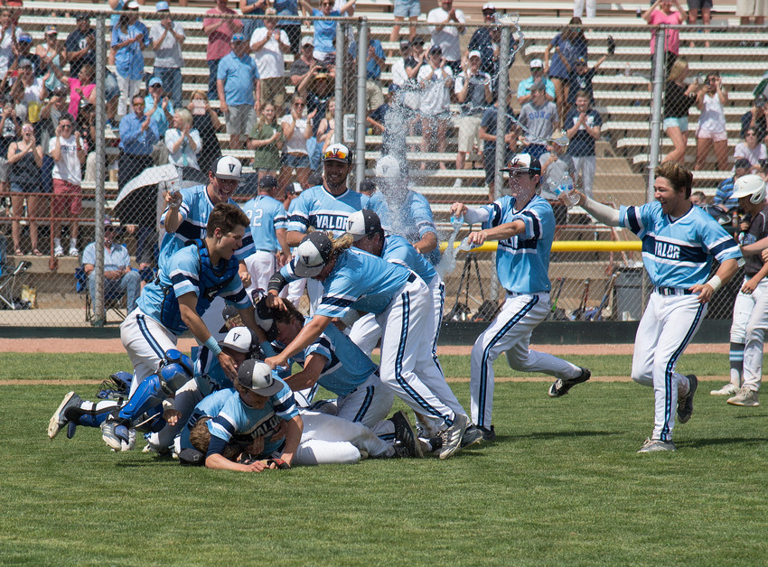 The Valor Christian Baseball team brings on the water bottle showers as they pile on for pitcher Radek Birkholz.  Birkholz had a no-hitter going into the seventh inning as the Eagles finished with the score of 5-1 to win the 4A state championship for the third year in a row.