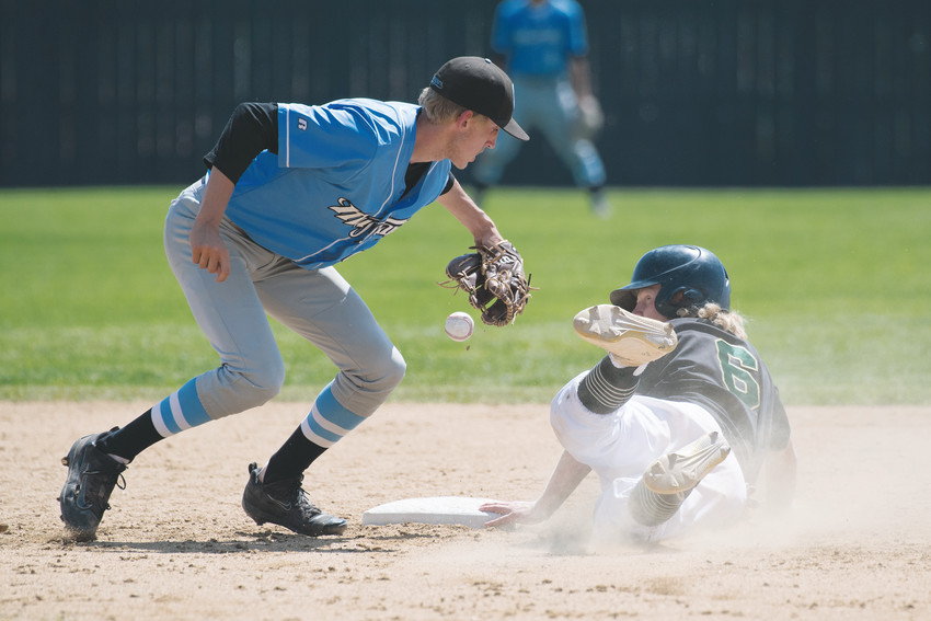 Mountain Range SS Mike Polson (4) makes a successful tag on Mountain Vista's Drew Stahl (6) but couldn't hold on resulting in Stahl being called safe.   Mountain Range was eliminated 14-4 in five innings by eventual State Champion Mountain Vista Sunday at All City Field in Denver.