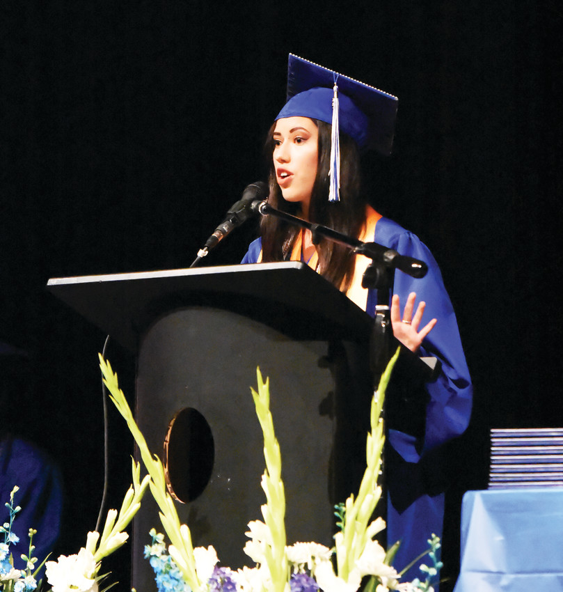 Valedictorian Caitlin Ryan, speaks at Westgate Community School's commencement ceremony, held May 29 at Mountain Range High School in Westminster. 14 graduates received diplomas from the Thornton-based charter school.