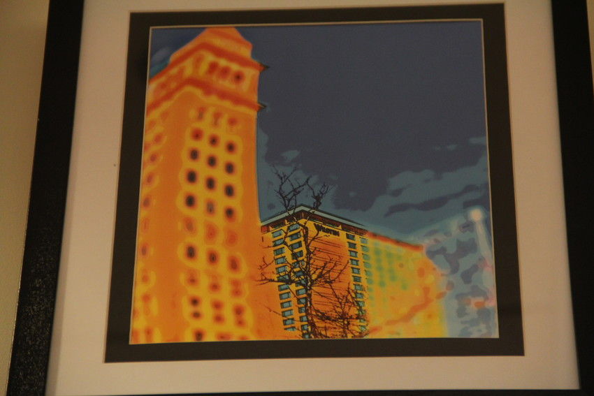 "A piece called ""Leaning D&F Tower"" at the Englewood Public Library June 1. It depicts buildings in downtown Denver. Dennis Behm often layers different effects on photos to give them a distinct look."