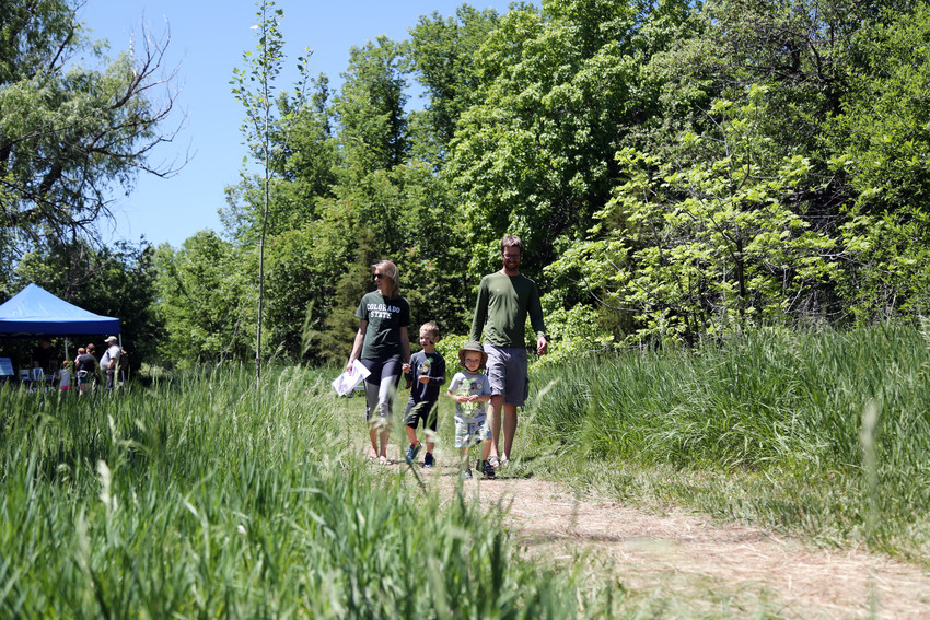 The McCatty family walks through Two Ponds National Wildlife Refuge on Arvada Trails Day, June 2. The family loves to take nature hikes togehter.