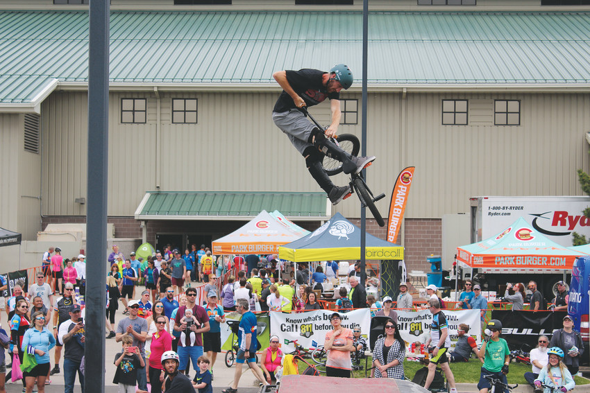 A BMX rider does a turndown trick in front of a crowd at the Elephant Rock Ride June 3.
