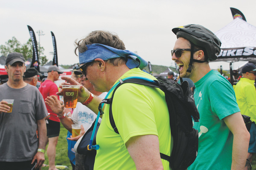 Two cyclists relax with an Elephant Rock IPA, the Pikes Peak Brewery beer named after the structure near Palmer Lake, after their ride at the Elephant Rock Ride June 3.