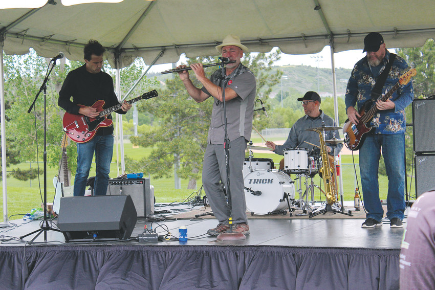 The Outliers' Jonny Love lays down a blues solo on his flute at the Elephant Rock Ride June 3.