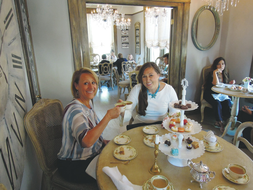 Littleton Mayor Debbie Brinkman, left, enjoys some tea with Cafe du Coco owner Natasha du Coco on June 2.