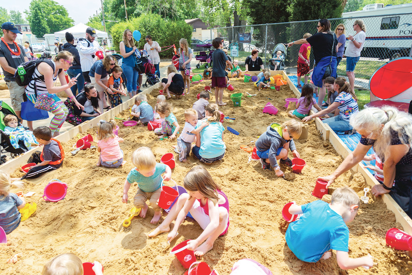 A giant sandbox allows kids to dig for buried treasure during the 2017 Sand in the City benefitting Hope House of Colorado.