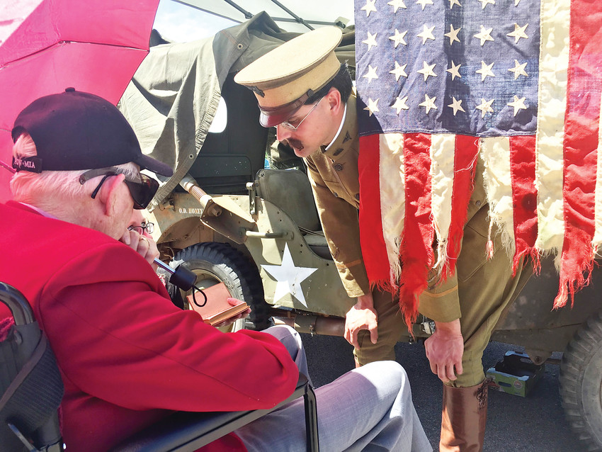 Malachi Springer, right, talks to a World War II veteran.