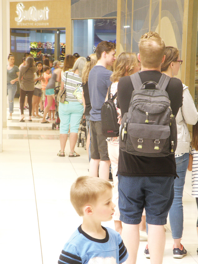 Lines stretch from the entrance to SeaQuest Interactive Aquarium, Southwest Plaza's newest family-oriented attraction.