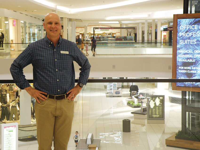 Southwest Plaza Mall general manager Greg Sims stands on one of the mall's revamped walkways. Southwest Plaza is emerging as a home of family attractions and dining in the years following a major renovation.