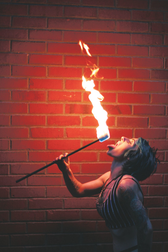 Fire eater Rose Pesca goes in for a spicy snack.