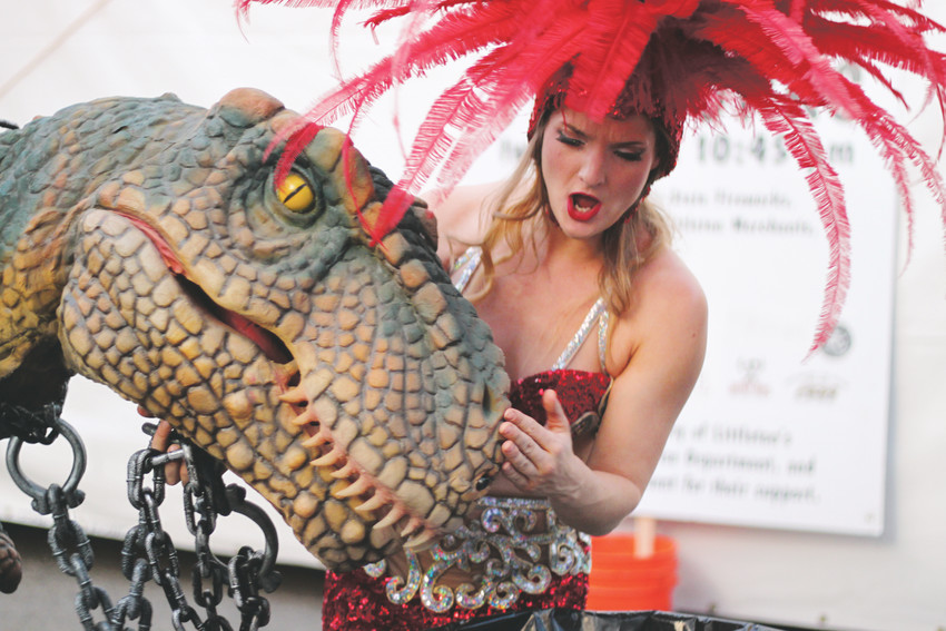 Grace Ramsey of Borrillo Entertainment scolds her pet dinosaur (actually an animatronic suit) as he gets into the trash.