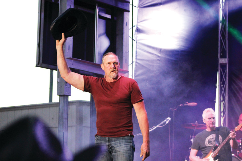 Trace Adkins waves his hat to the crowd as he appears for his first concert appearance in Parker for the 2018 Parker Days Festival.
