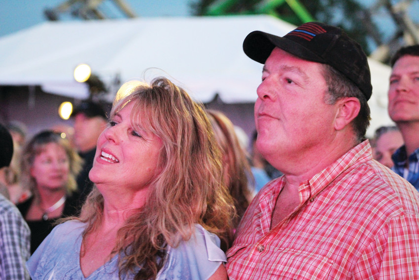 A couple enjoy the Trace Adkins concert during the first day of the 2018 Parker Days Festival. Adkins was the biggest name to headline Parker Days in the festival's 30-year history.