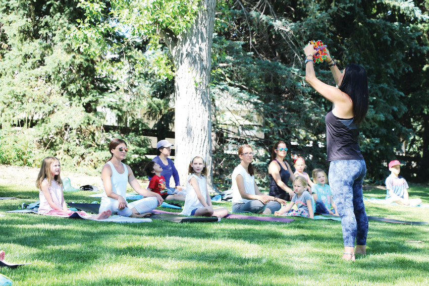 Wendy Crichton uses a colorful sphere to demonstrate breathing in and out at a Young Yogis class on June 8 at Northridge Park, 8800 S. Broadway. The class for ages 6-11 is held Fridays in June from 10-11 a.m.