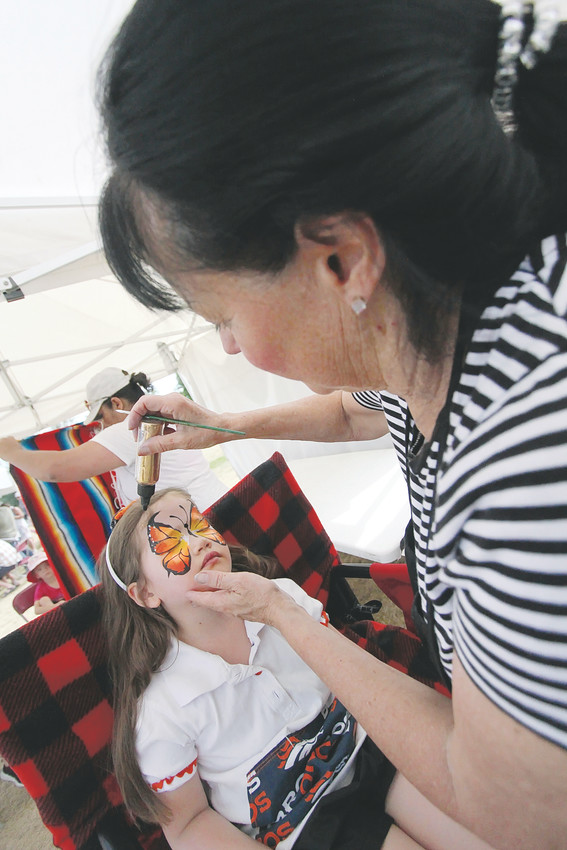 Face painting was just one of the activities the youngest of the spectators at this year's criterium could enjoy in the Kids' Zone
