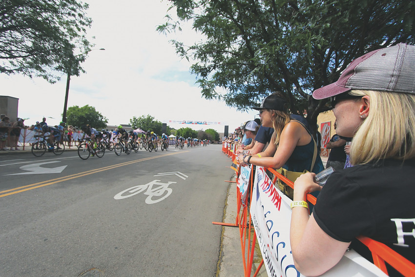 Spectators along the route in Wheat Ridge watch the racers zip by.