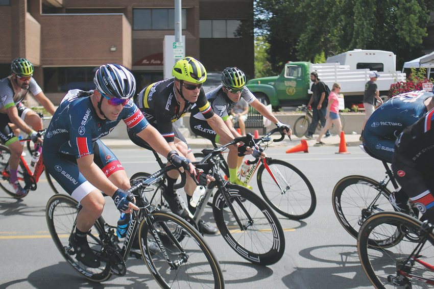 Riders in the 2018 Ridge at 38 Criterium cross 38th Avenue as they begin another circuit of the race course.