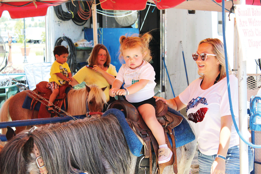 A girl saddles up on a pony June 9 at the 2018 Parker Days Festival.