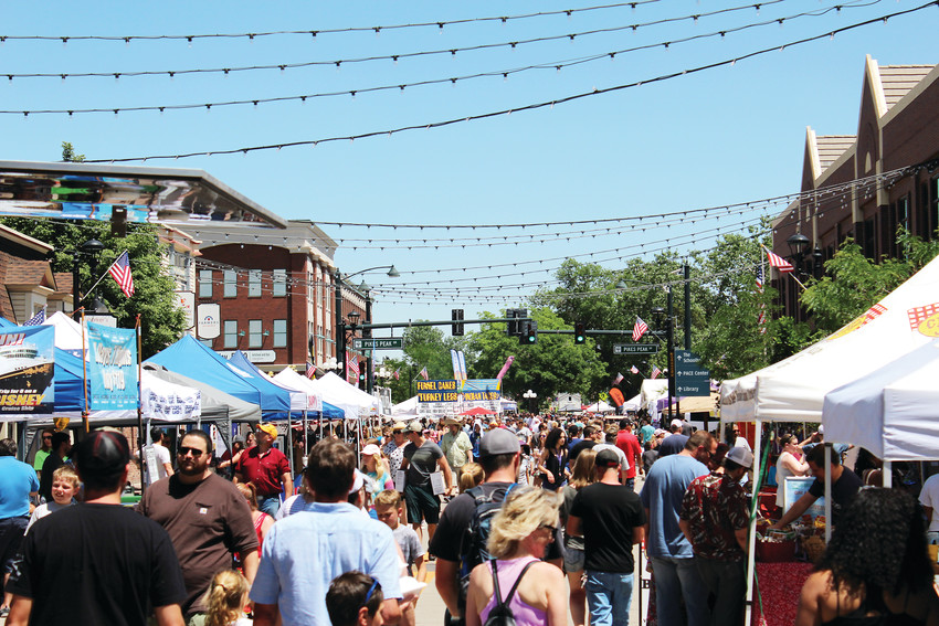 People file down Mainstreet in downtown Parker June 9 at the 2018 Parker Days. It is the 31st official event of the four-day festival where families from throughout the Denver metro area gather for summer fun.