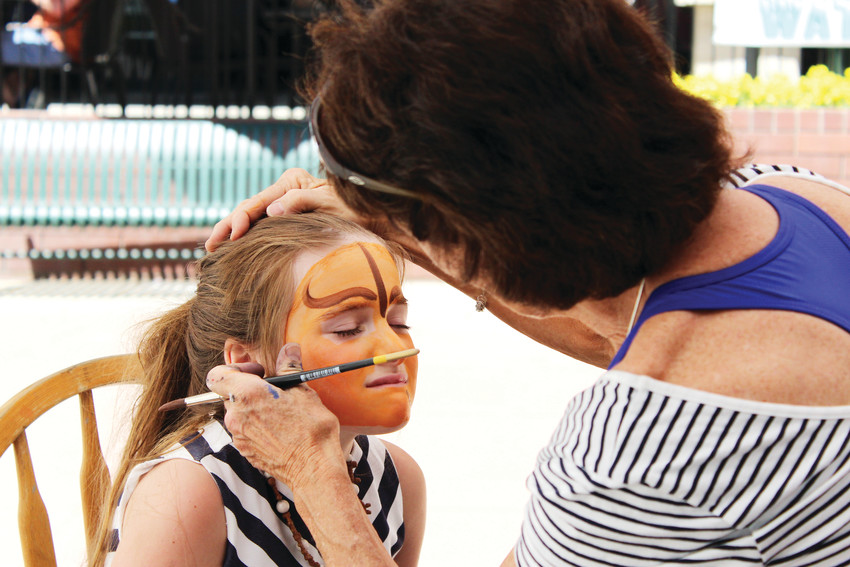 A girl has her face painted June 9 at the 2018 Parker Days Festival.