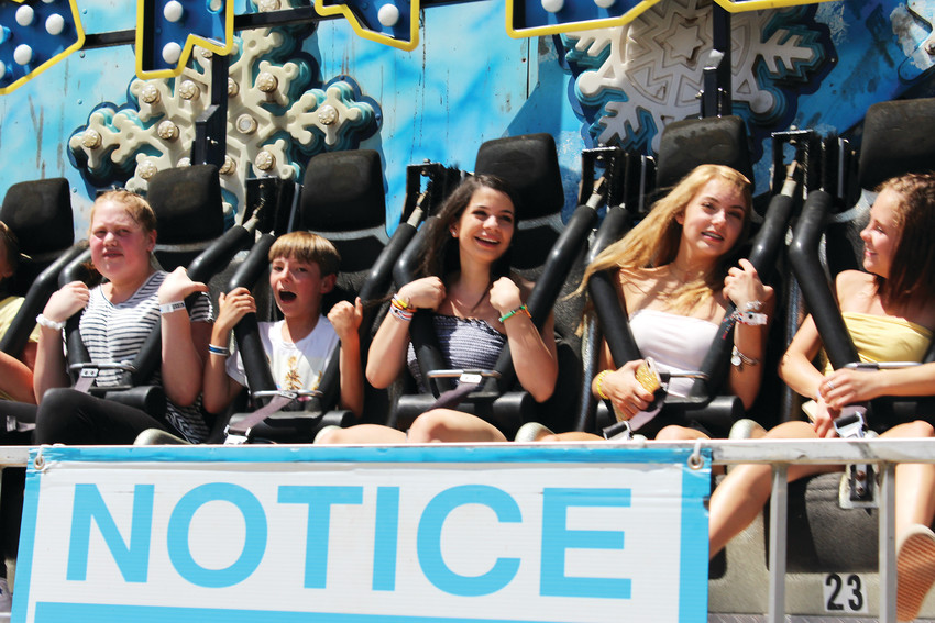 Teens scream and smile on the Avalanche ride June 9 at the 2018 Parker Days Festival.