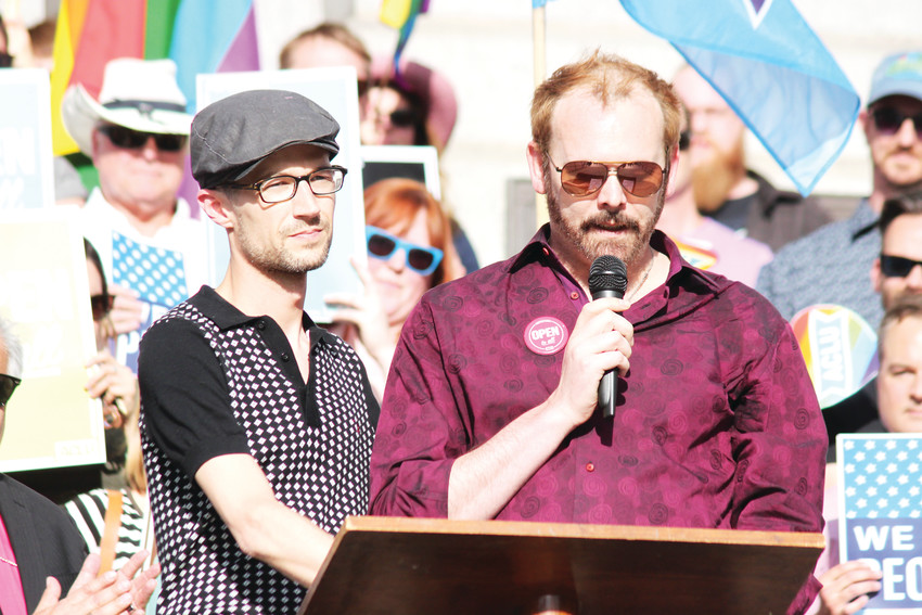 Charlie Craig, right, and his husband David Mullins, speaking at a rally last week held by ONE Colorado in opposition to the Supreme Court decision against the couple who filed suit against Lakewood's Masterpiece Cakeshop in 2012, after they were denied a wedding cake.