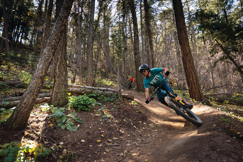 People come from all over the world to demo Yeti Cycles' mountain bikes on local trails. Pictured is a person riding in the Enchanted Forest on Apex Trail.