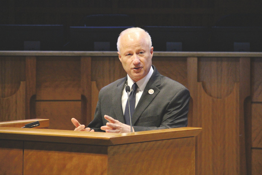 U.S. Rep. Mike Coffman, R-Aurora, talks to a crowd in the Aurora City Council chambers June 11 at an event called the Innovative Housing Symposium organized by Mile High Behavioral Healthcare. Coffman discussed his proposed legislation, the Homeless Veteran Families Act, which seeks to provide assistance to veterans' children.
