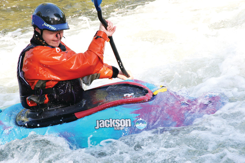 Annie Aldrich of Golden competes in the Golden Community Rodeo Series' freestyle kayak competition on June 13 at Clear Creek Whitewater Park in Golden. Put on by Colorado Whitewater, the series is in its 17th year.