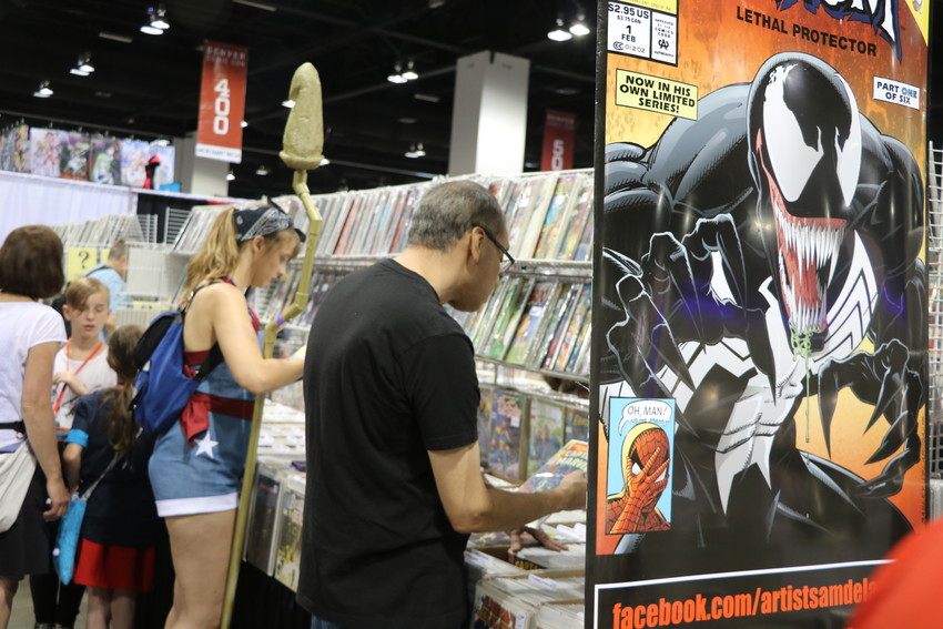 Shoppers peruse the stacks at this year's Denver Comic Con. More than 100,000 people visited the Colorado Convention Center on June 15, 16, and 17 to indulge their nerdy side.