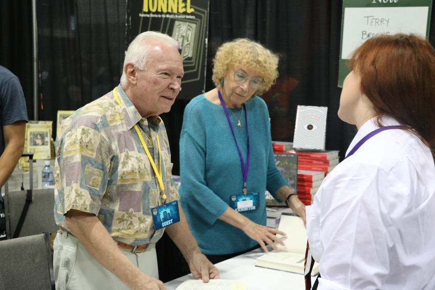 New York Times bestselling author Terry Brooks visits with fans at the Tattered Cover booth at Denver Comic Con.