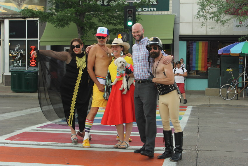 Shawna Slavinski, Todd Colletti,Maggie Thompson, Councilman Jolon Clark, and Greg Maronde posed on the new rainbow crosswalk on Broadway. The group raised $31,000 to install the crosswalk.
