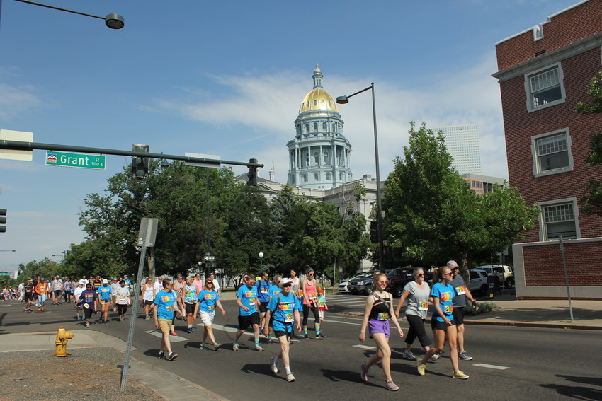 Participants in the Pride 5k cross Grant Street on 14th Avenue on June 16.