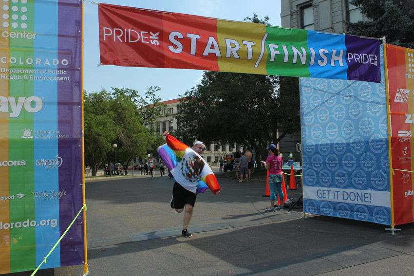 Ivan Montes crosses the finish line of the Pride 5k on June 16. The 5k run kicked off the festival Saturday morning.